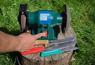 Photo of one of our tree surgeons about to undertake stump grinding in Stroud.